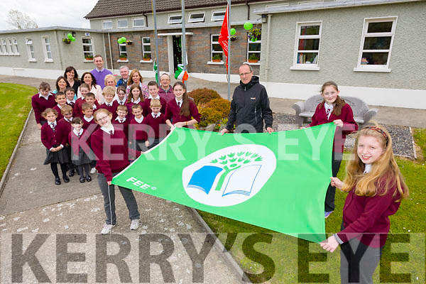 Michael O Coileaim from Kerry County Council Envoironment section helped raise the Lyreacrompane ns  5th Green Flag (Greener Home) on Thursday