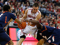 Ohio State Buckeyes guard Aaron Craft (4) drives into Illinois Fighting Illini in the first half at Value City Arena in Columbus Jan. 23, 2013 (Dispatch photo by Eric Albrecht)