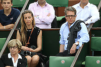 Anna Eberstein and Hugh Grant watching tennis during Roland Garros tennis open 2016 on may 25 2016.