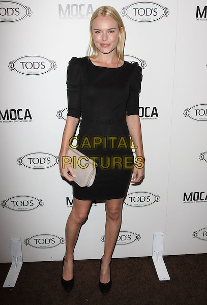 KATE BOSWORTH.Tod's Beverly Hills boutique Grand Opening held At Tod's Boutique, Beverly Hills, California, USA. .April 15th, 2010 .full length black dress ruched puff sleeve sleeves shoes white cream clutch bag beige .CAP/ADM/KB.©Kevan Brooks/AdMedia/Capital Pictures.