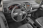 High angle dashboard view of a  2009 Nissan Frontier Crew Cab SE