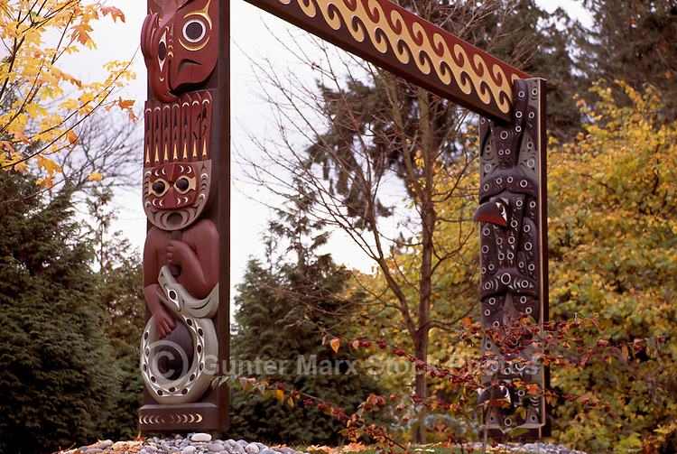 Carved Coast Salish Totem Gateway at Brockton Point in Stanley Park, Vancouver, BC, British Columbia, Canada, Autumn / Fall