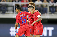 WASHINGTON, D.C. - OCTOBER 11: Christian Pulisic #10 of the United States scores a penalty kick goal and celebrates with teammates during their Nations League game versus Cuba at Audi Field, on October 11, 2019 in Washington D.C.