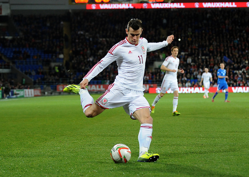 Wales Gareth Bale in action during todays match  <br /> <br /> Photo by Ian Cook/CameraSport<br /> <br /> Football - International Friendly - Wales v Iceland - Saturday 5th March 2014 - Cardiff City Stadium - Cardiff<br /> <br /> &Acirc;&copy; CameraSport - 43 Linden Ave. Countesthorpe. Leicester. England. LE8 5PG - Tel: +44 (0) 116 277 4147 - admin@camerasport.com - www.camerasport.com