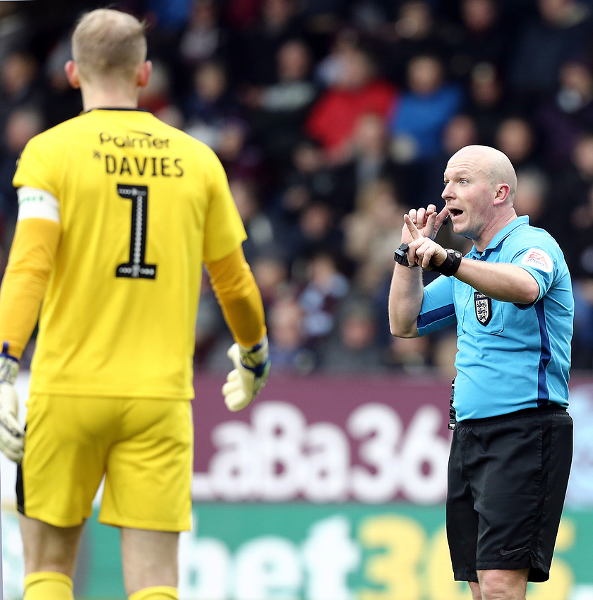 Referee Simon Hooper gestures to Barnsley's Adam Davies as he reverses his penalty decision when a VAR referral showed Burnley's Matej Vydra to be off-side<br /> <br /> Photographer Rich Linley/CameraSport<br /> <br /> Emirates FA Cup Third Round - Burnley v Barnsley - Saturday 5th January 2019 - Turf Moor - Burnley<br />  <br /> World Copyright © 2019 CameraSport. All rights reserved. 43 Linden Ave. Countesthorpe. Leicester. England. LE8 5PG - Tel: +44 (0) 116 277 4147 - admin@camerasport.com - www.camerasport.com