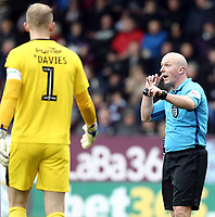 Referee Simon Hooper gestures to Barnsley's Adam Davies as he reverses his penalty decision when a VAR referral showed Burnley's Matej Vydra to be off-side<br /> <br /> Photographer Rich Linley/CameraSport<br /> <br /> Emirates FA Cup Third Round - Burnley v Barnsley - Saturday 5th January 2019 - Turf Moor - Burnley<br />  <br /> World Copyright &copy; 2019 CameraSport. All rights reserved. 43 Linden Ave. Countesthorpe. Leicester. England. LE8 5PG - Tel: +44 (0) 116 277 4147 - admin@camerasport.com - www.camerasport.com