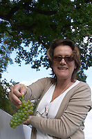 Harvested grapes. Nathalie d'Estutt d'Assay, of the owning family. Chateau de Tracy, Pouilly sur Loire, France