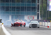 Mar 16, 2019; Gainesville, FL, USA; NHRA factory stock driver David Barton (left) crashes alongside Chris Holbrook during the Gatornationals at Gainesville Raceway. Mandatory Credit: Mark J. Rebilas-USA TODAY Sports
