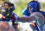 Nevada's Garrett Felling, right, and Air Force's Laurynas Galdikas compete in an intercollegiate boxing match at TJ's Corral at Carson Valley Inn, in Minden, Nev., on Saturday, Sept. 13, 2014. Felling won on a TKO.<br /> Photo by Cathleen Allison