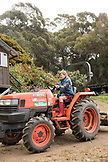 USA, California, Big Sur, Esalen, farmer Kat takes the tractor to The Farm to till a field