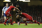Wales pair Rhys Webb and Paul James combine to stop All Blacks wing Julian Savea.<br /> Dove men Series 2014<br /> Wales v New Zealand<br /> 22.11.14<br /> &copy;Steve Pope -SPORTINGWALES