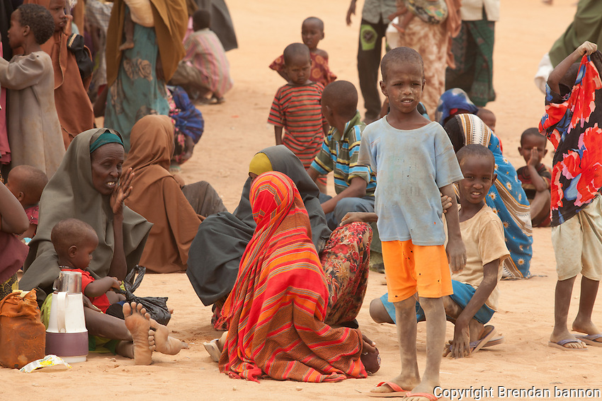 Newly arrived Somali refugees waiting at the reception center in Dagahaley camp. They will be finger printed and have  medical screening and set appointments for formal registration. dadaab, Kenya is home to the world's largest refugee camp with nearly 500,000 people. 2011 saw historically high rates of arrival due to drought and continued insecurity in Somalia. October, 2011.