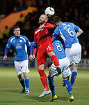 Kris Boyd wins the inswinging ball from a corner kick