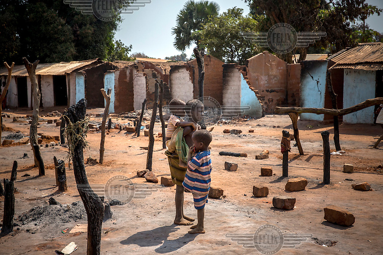 A young girl stands among the charred remains of shops, some burned by fleeing Seleka rebels and others burned by Anti-Balaka vigilantes in revenge. In 2013 a rebellion by a predominantly Muslim rebel group Seleka, led by Michel Djotodia, toppled the government of President Francios Bozize. Djotodia declared that Seleka would be disbanded but as law and order collapsed the ex-Seleka fighters roamed the country committing atrocities against the civilian population. In response a vigillante group, calling themselves Anti-Balaka (Anti-Machete), sought to defend their lives and property but they then began to take reprisals against the Muslim population and the conflict became increasingly sectarian. French and Chadian peacekeeping forces have struggled to contain the situation and the smaller Muslim population began to flee the country.