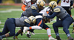Althoff players (from left) DeAndre Lenard, Damion Stokely, and Anthony Hughes take down Carterville running back Markas Lazdinas as he carries the ball in the first half. The Althoff Catholic High School Crusaders defeated the Carterville Lions 42-0 in a first-round Illinois High School Association Class 4A football playoff game on Saturday October 28, 2017 in Belleville.