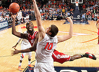 North Carolina State forward C.J. Leslie (5) shoots next to Virginia forward/center Mike Tobey (10) during the game Saturday in Charlottesville, VA. Virginia defeated NC State 58-55.