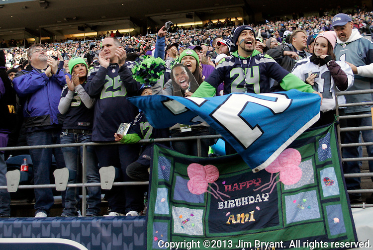 Seattle Seahawks  fan cheer as the Seahawks rush onto the field at CenturyLink Field in Seattle, Washington on  November 17, 2013.  The Seahawks beat the Vikings 41-20.  ©2013.  Jim Bryant. All Rights Reserved.