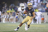 Annapolis, MD - September 8, 2018: Navy Midshipmen quarterback Malcolm Perry (10) runs the ball during the game between Memphis and Navy at  Navy-Marine Corps Memorial Stadium in Annapolis, MD.   (Photo by Elliott Brown/Media Images International)