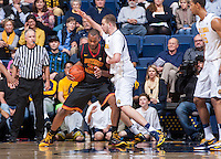 California's Kameron Rooks defending USC's D.J. Haley during a game at Haas Pavilion in Berkeley, California on February 23th, 2014. California defeated USC 77 - 64