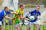 Donegal'sAnthony Thompson gets the ball away under pressure from Barry John Keane and Declan O'Sullivan during their Allainz league clash in Fitzgerald Stadium on Sunday