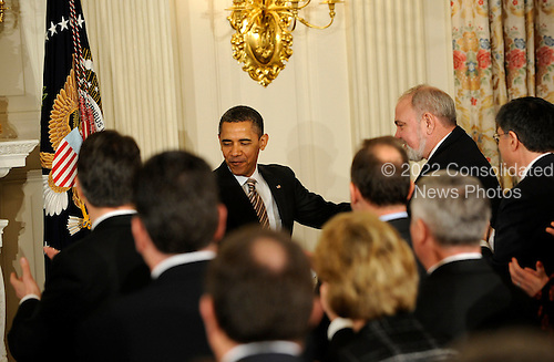 United States President Barack Obama greets governors after delivering remarks to the National Governors Association during a meeting in the White House State Dining Room on Monday, February 27, 2012, in Washington, DC.  .Credit: Leslie E. Kossoff / Pool via CNP