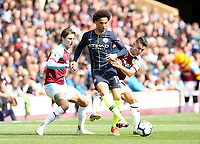 Manchester City's Leroy Sane under pressure from Burnley's Jeff Hendrick (left) and Ashley Westwood<br /> <br /> Photographer Rich Linley/CameraSport<br /> <br /> The Premier League - Burnley v Manchester City - Sunday 28th April 2019 - Turf Moor - Burnley<br /> <br /> World Copyright © 2019 CameraSport. All rights reserved. 43 Linden Ave. Countesthorpe. Leicester. England. LE8 5PG - Tel: +44 (0) 116 277 4147 - admin@camerasport.com - www.camerasport.com