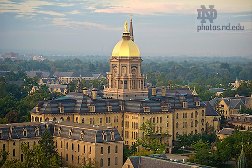 Sept. 25, 2013; The statue of Mary atop the Golden Dome of the Main Building at sunrise. Photo by Barbara Johnston/University of Notre Dame