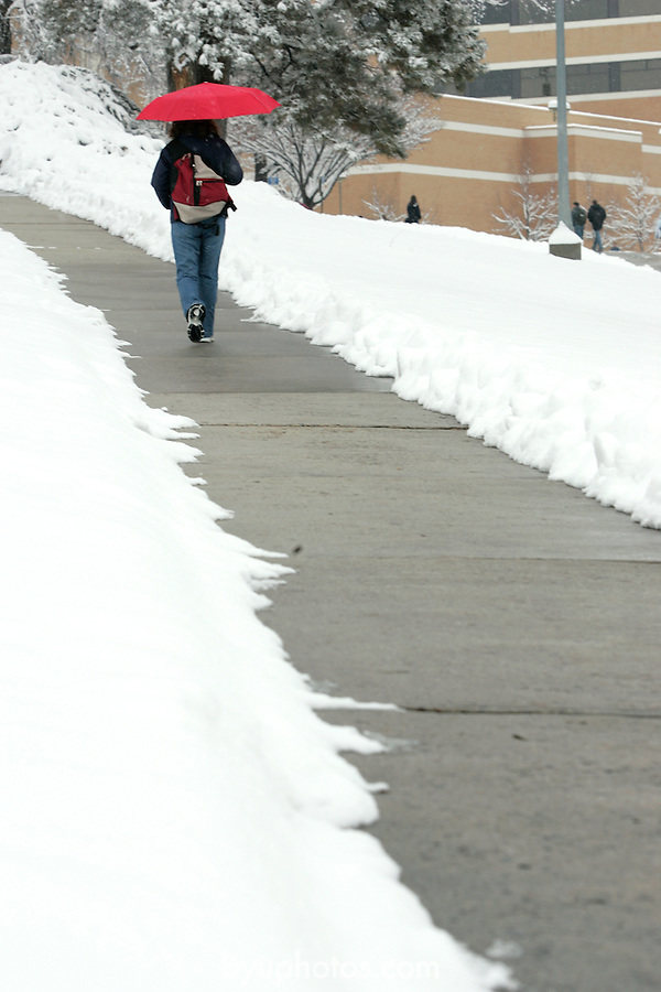 .0501-17 GCS Snow..Photo by Jaren Wilkey/BYU..Copyright BYU Photo 2005.All Rights Reserved.photo@byu.edu  (801)422-7322.1/5/05..Students walking in snow, Karl Maeser Building, Lower Campus Walkway, Maeser Hill