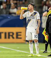 CARSON, CA - SEPTEMBER 21: Cristian Pavon #10 of the Los Angeles Galaxy has water during a game between Montreal Impact and Los Angeles Galaxy at Dignity Health Sports Park on September 21, 2019 in Carson, California.