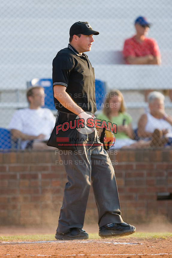 Umpire Luke Engen handles the balls and strikes during an Appalachian League game between the Elizabethton Twins and the Johnson City Cardinals at Howard Johnson Field July 3, 2010, in Johnson City, Tennessee.  Photo by Brian Westerholt / Four Seam Images
