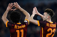 Calcio, Serie A: Roma vs Fiorentina. Roma, stadio Olimpico, 4 marzo 2016.<br /> Roma&rsquo;s Stephan El Shaarawy, right, celebrates with teammate Mohamed Salah after scoring during the Italian Serie A football match between Roma and Fiorentina at Rome's Olympic stadium, 4 March 2016.<br /> UPDATE IMAGES PRESS/Riccardo De Luca