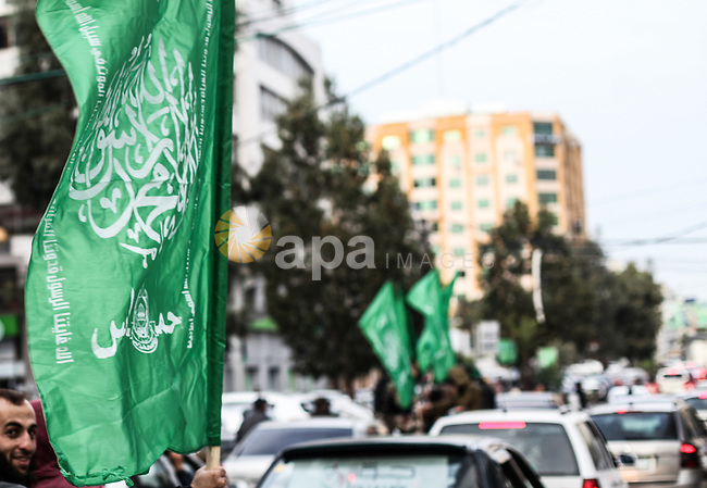 Members of Hamas' armed wing al-Qassam Brigades walk in a street, marking the 32th anniversary of the founding of the Hamas movement, in Gaza city on December 11, 2019. Photo by Mahmoud Ajjour