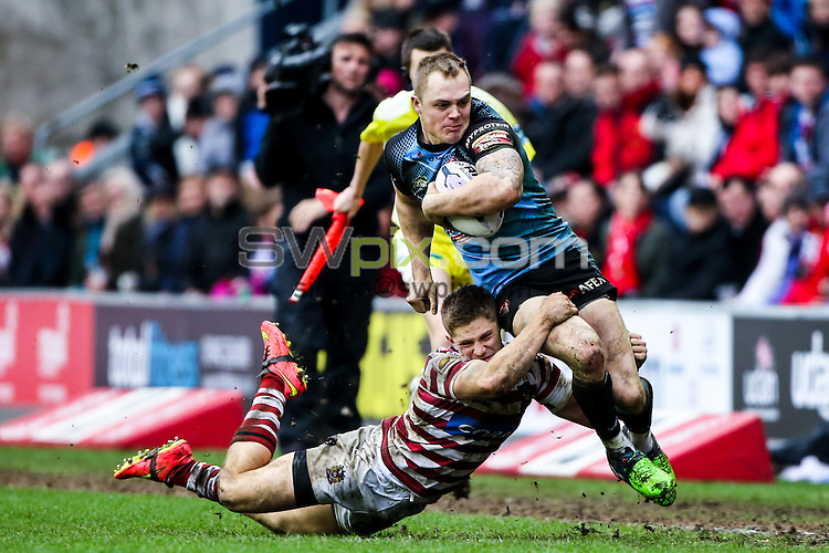 Picture by Alex Whitehead/SWpix.com - 03/04/2015 - Rugby League - First Utility Super League - Wigan Warriors v St Helens - DW Stadium, Wigan, England - St Helens' Adam Swift is tackled by Wigan's Ryan Hampshire.