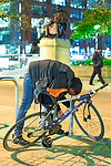 © Joel Goodman - 07973 332324 . 07/04/2017 . Manchester , UK . A man stands prone bent over a bike rack , unmoving , in what is believed to be the consequence of smoking spice , in Piccadilly Gardens . Greater Manchester Police have authorised dispersal powers and say they will ban people from the city centre for 48 hours , this evening (7th April 2017) , in order to tackle alcohol and spice abuse . Photo credit : Joel Goodman