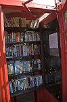 Old red telephone box used for book exchange, Suffolk, England