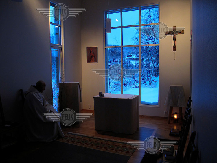"""Brother Cyril do early morning prayer. The new Munkeby Mariakloster - kloster is Norwegian for monastery . The four founding French monks will establish their discrete presence as a contemplative monastery according to the Rule of Saint Benedict, written in the 6th century. Brother Joel (55) & Cîteaux's Prior, brothers Arnaud (31), Bruno (33) and Cyril (81), have all chosen to be part of the founding community, despite Norway's rude climate and winter darkness at latitude 63º N, not far from the arctic circle.Munkeby, the """"place of the monks"""" was the third and northernmost Norwegian monastery established by the Cistercians in the 12th century"""