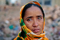 A Bangladeshi woman who lost her son in the Rana Plaza building collapse cries at the site of the accident, the worst in the history of the garment industry, on the eve of the tragedy in Savar, near Dhaka, Bangladesh.