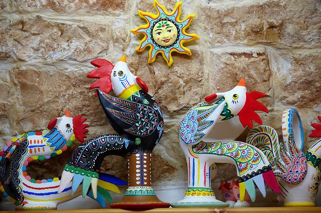 Trulli whistle shop La Botega die Finchietti, interior.  Ornate traditional folk art whistles of the region. Alberobello, Puglia, Italy.  Pictures, photos, images & fotos.