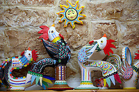 Trulli whistle shop La Botega die Finchietti, interior.  Ornate traditional folk art whistles of the region. Alberobello, Puglia, Italy.  Pictures, photos, images & fotos.