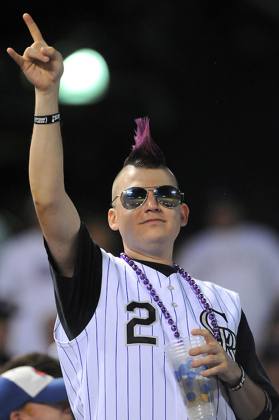 18 JULY 2011: A Colorado Rockies fan in a Tulowitzki jersey wityh a purple mohawk and reflective aviator glasses enjoys the game with a beer  during a regular season game between the Atlanta Braves and the Colorado Rockies at Coors Field in Denver, Colorado. The Braves beat the Rockies 7-4. *****For Editorial Use Only*****
