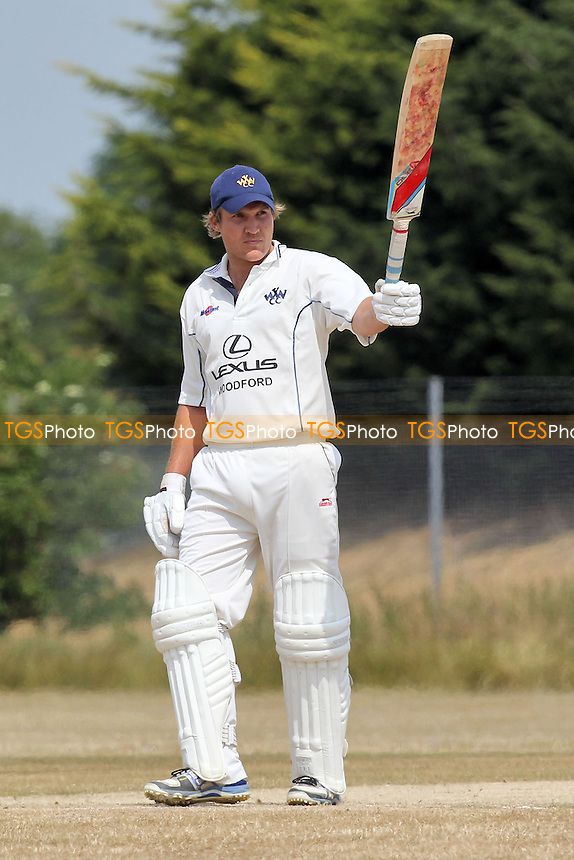 A Baars of Woodford Wells acknowledges a half-century, 50 runs for his team - Hainault & Clayhall CC vs Woodford Wells CC - Essex Cricket League - 13/07/13 - MANDATORY CREDIT: Gavin Ellis/TGSPHOTO - Self billing applies where appropriate - 0845 094 6026 - contact@tgsphoto.co.uk - NO UNPAID USE