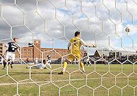 Ben Slingerland #23 of Georgetown University heads the ball past Jhojan Obando #1 of Providence University for Georgetown's goal during a Big East quarter-final  match at North Kehoe Field, Georgetown University on November 6 2010 in Washington D.C. Providence won 2-1.
