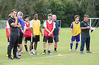 Orlando, FL - Friday Oct. 14, 2016:   Patryk Seppelt-Gorajewski and coaching instructor Louis Mateus observe a training session during a US Soccer Coaching Clinic in Orlando, Florida.
