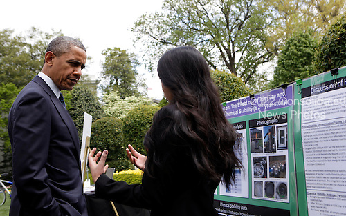United States President Barack Obama  speaks with American Natural History Museum Young Naturalist Award winner Meghana Rao from Portland Oregon in the East Garden of the White House in Washington, D.C. during the White House Science Fair on April 22, 2013. The White House Science Fair celebrates the student winners of a broad range of science, technology, engineering and math (STEM) competitions from across the country. The first White House Science Fair was held in late 2010. <br /> Credit: Aude Guerrucci / Pool via CNP