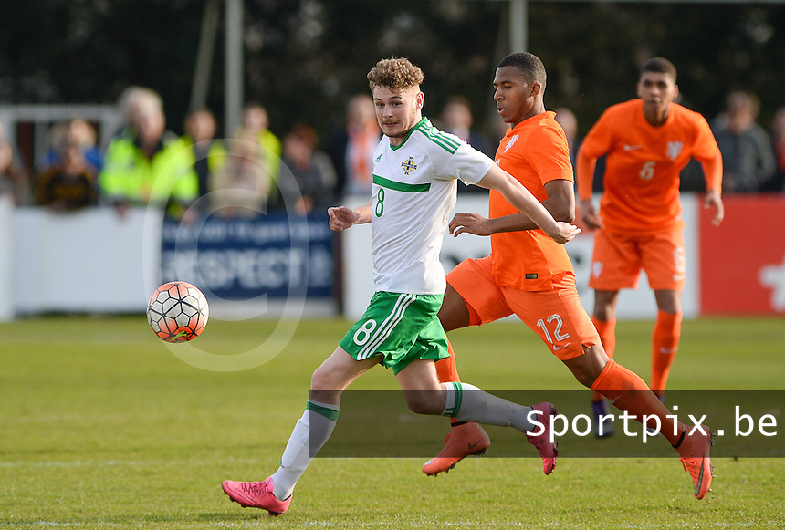 20160326  - Uden , NETHERLANDS : Northern Irish Ben Kennedy (8) pictured in a duel with Dutch Jurich Carolina (12) during the soccer match between the under 19 teams of The Netherlands and Northern Ireland , on the second matchday in group 4 of the UEFA Under19 Elite rounds in Uden , Netherlands. Saturday 26 th March 2016 . PHOTO DAVID CATRY