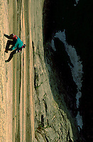 Rock climber making an ascent on the direct north west face route on Half Dome in Yosemite, California.