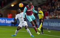 Bafetibis Gomis of Swansea City and Angelo Ogbonna Obinze of West Ham United in action during the Barclays Premier League match between Swansea City and West Ham United played at The Liberty Stadium, Swansea on 20th December 2015