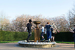 Hipsters sing and dance around a fountain in Regent's Park, London, England