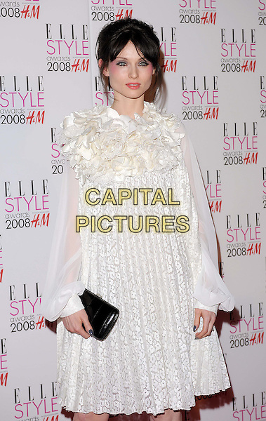 SOPHIE ELLIS-BEXTOR.Attending the ELLE Style Awards 2008,.The Westway, London, England,.February 12th 2008..half length cream white ruffle front dress black clutch bag purse fringe make-up.CAP/BEL.©Tom Belcher /Capital Pictures