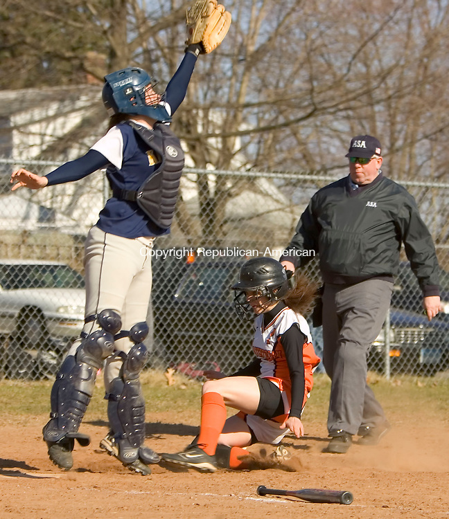 WATERTOWN, CT--10 APRIL 2007--041007JS12-Watertown's Ashley Cipriano (7) slides underneath Kennedy catcher Val Tooth (1) and scores a run during their 20-0 win over Kennedy High School Tuesday at Watertown High School. <br /> Jim Shannon / Republican-American